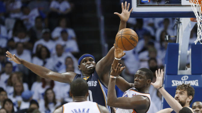 Oklahoma City Thunder guard Reggie Jackson (15) passes to Serge Ibaka (9) as Memphis Grizzlies forward Zach Randolph defends, during the first half of Game 5 of an NBA basketball playoffs Western Conference semifinal in Oklahoma City, Wednesday, May 15, 2013. (AP Photo/Sue Ogrocki)