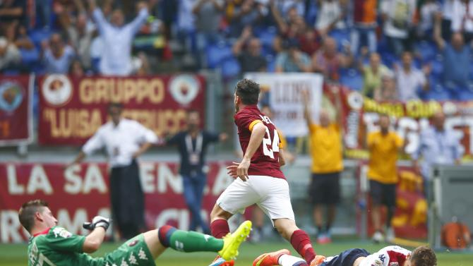 AS Roma's Florenzi celebrates after scoring against Cagliari during their Italian Serie A soccer match at the Olynpic stadium in Rome