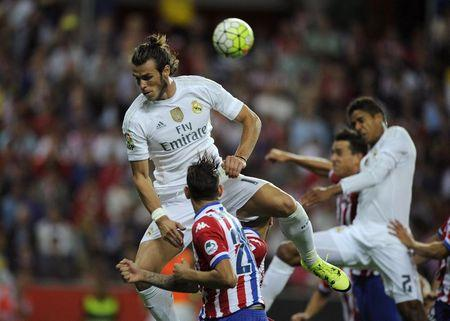 Real Madrid's Bale and Sporting's Sanabria fight for a high ball during their Spanish first division soccer match at El Molinon stadium in Gijon