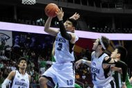 Adamson's Eric Camson dirives to the basket. (NPPA Images)