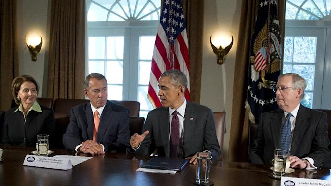President Barack Obama, joined by from left, House Minority Leader Nancy Pelosi of Calif., House Speaker John Boehner of Ohio, and Senate Majority Leader Mitch McConnell of Ky., right, speaks to media as he meets with bipartisan, bicameral leadership of Congress in the Cabinet Room of the White House in Washington, Tuesday, Jan. 13, 2015, to discuss a wide range of issues. (AP Photo/Carolyn Kaster)