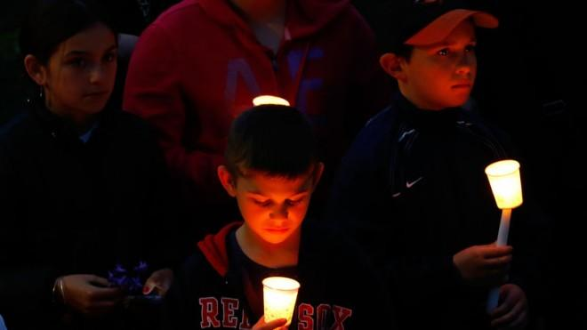 Young children attend a vigil for 8-year-old Martin Richard, from Dorchester, who was killed by explosions at the Boston Marathon.