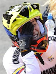 Colombia's Mariana Pajon celebrates after winning the BMX cycling women's final event at the London 2012 Olympic Games in the Olympic Park in east London on August 10, 2012. AFP PHOTO / LEON NEAL
