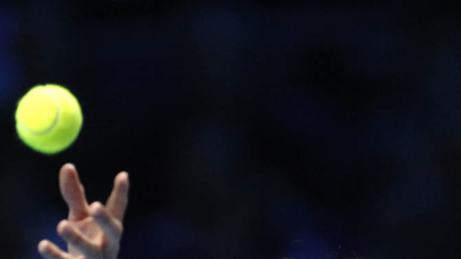 Roger Federer of Switzerland serves to Juan Martin Del Potro of Argentina, during their singles tennis match at the ATP World Tour Finals,  in London, Saturday, Nov. 10, 2012. (AP Photo/Sang Tan)