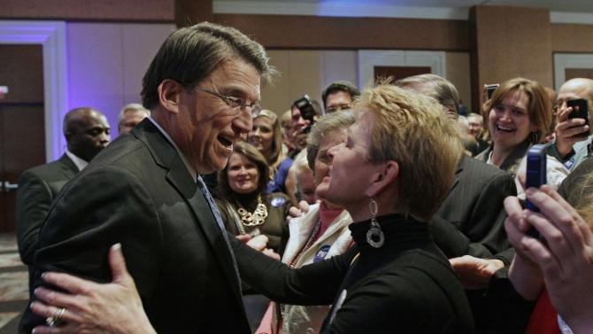 Pat McCrory greet supporters at his election night headquarters in Charlotte, N.C., Tuesday, Nov. 6, 2012 after being elected governor of North Carolina. (AP Photo/Chuck Burton)