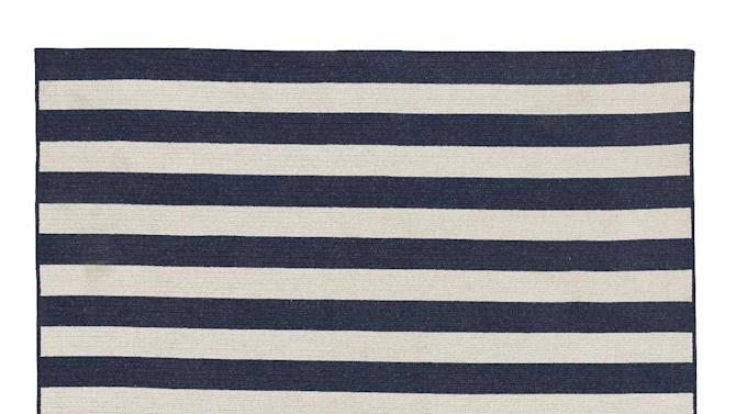 This undated publicity photo provided by Restoration Hardware Baby and Child shows a bold striped, braided wool rug, a great way to introduce navy to a room (www.rhbabyandchild.com).  With bold pops of color, or a few soothing neutrals, navy is a fresh trend worth exploring this spring.  (AP Photo/Restoration Hardware Baby and Child)