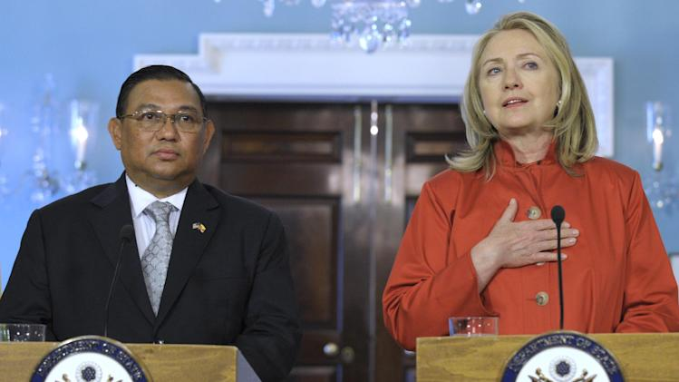 Secretary of State Hillary Rodham Clinton, accompanied by Myanmar Foreign Minister U Wunna Maung Lwin, speaks at the State Department in Washington, Thursday, May 17, 2012. (AP Photo/Susan Walsh)