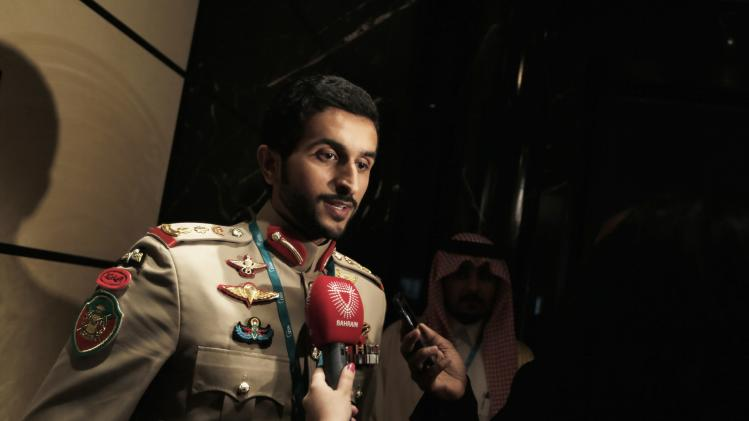 Commander of Bahrain's Royal Guard Colonial Sheikh Nasser bin Hamad al-Khalifa speaks to journalists after close session meeting at IISS Regional Security Summit - The Manama Dialogue after speech in Manama