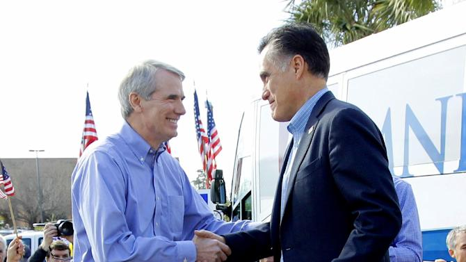 FILE - In this Jan. 19, 2012 file photo, Republican presidential candidate, former Massachusetts Gov. Mitt Romney, is introduced by Sen. Rob Portman, R-Ohio, at his campaign headquarters in Charleston, S.C. When Republican presidential candidate Mitt Romney picks his running mate, odds are he'll select someone with far less wealth than his own. Unless he chooses Hewlett-Packard CEO Meg Whitman, one of the richest women in America. Some of the potential Republican vice presidential nominees are grappling with the same financial issues as many of their countrymen. (AP Photo/Charles Dharapak, File)