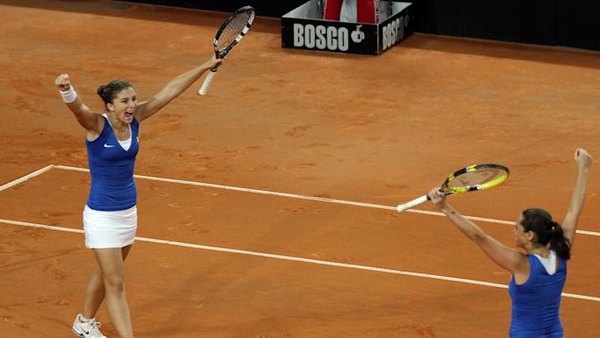 Italy's Sara Errani, left, and Roberta Vinci celebrate at the end of a Fed Cup World group first round tennis double match against United States' Varvara Lepchenko and Liezel Huber, at the 105 stadium in Rimini, Italy, Sunday, Feb. 10, 2013. Italy beat the USA to progress to the Fed Cup semifinals after Sara Errani and Roberta Vinci cruised to victory over Varvara Lepchenko and Liezel Huber in the decisive doubles rubber on Sunday. Errani and Vinci proved again just why they are the top doubles pairing as they won 6-2, 6-2 in one hour and 11 minutes. (AP Photo/Felice Calabro')