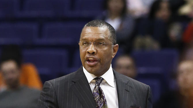 "In this photo taken Thursday, Jan. 17, 2013, Phoenix Suns' head coach Alvin Gentry argues with officials during an NBA basketball game against the Milwaukee Bucks, in Phoenix.  After five-plus seasons, Gentry is stepping down as head coach today as Gentry and the team ""have mutually agreed to part ways"" according to team officials.(AP Photo/Ross D. Franklin)"