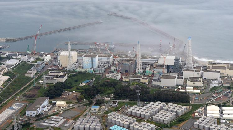 FILE - In this Tuesday, Aug. 20, 2013 file aerial photo, the Fukushima Dai-ichi nuclear plant is seen at Okuma in Fukushima prefecture, northern Japan. The storage tank problems have captured international attention, especially since August, when a 1,000-ton tank lost nearly one-third of its toxic content. A month earlier, the plant's operator, Tokyo Electric Power Co., acknowledged that much larger amounts of contaminated underground water at the site have been leaking into the Pacific for some time. (AP Photo/Kyodo News, File) JAPAN OUT, MANDATORY CREDIT