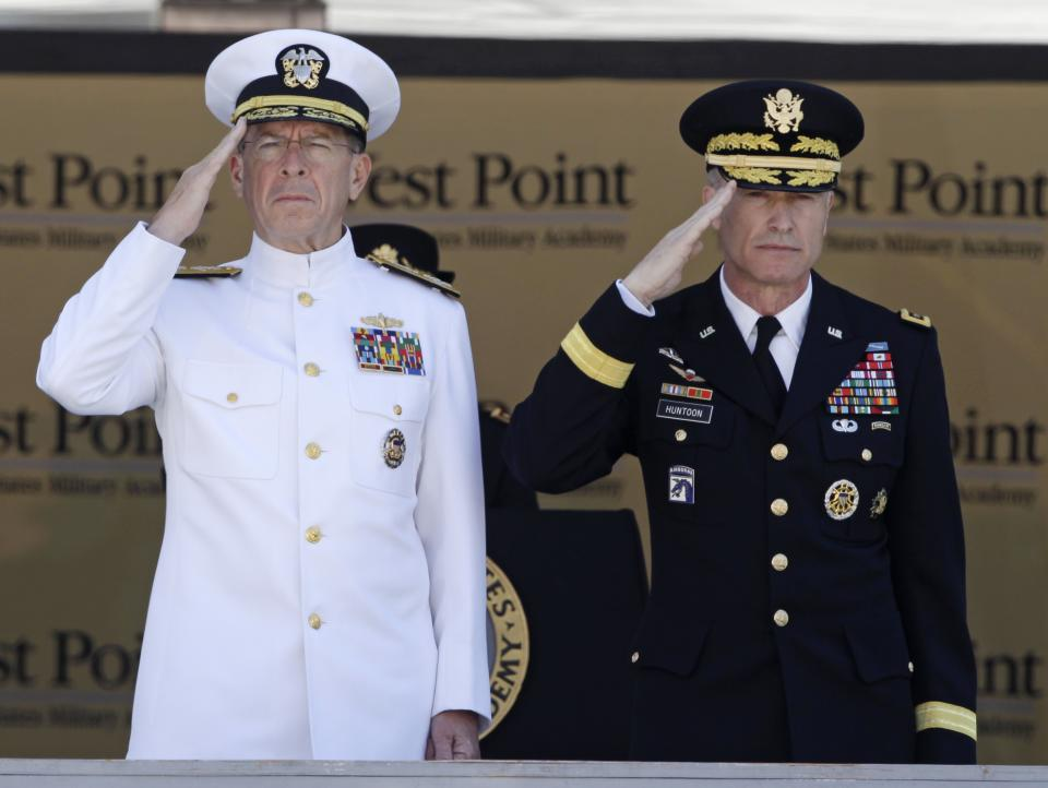 Joint Chiefs Chairman Adm. Mike Mullen, left, and Superintendent Lt. Gen. David Huntoon, Jr., salute during the national anthem during a graduation and commissioning ceremony at the U.S. Military Academy in West Point, N.Y., on Saturday, May 21, 2011.   (AP Photo/Mike Groll)
