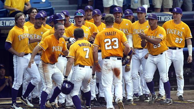 LSU's Sean McMullen (7) and Jake Fraley (23) celebrate with teammates after McMullen hit a two-run homer during the eighth inning against Florida during the Southeastern Conference NCAA college baseball tournament on Sunday, May 25, 2014, in Hoover, Ala. (AP Photo/Butch Dill)