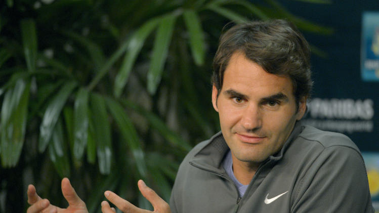 Roger Federer, of Switzerland, speaks during a news conference at the BNP Paribas Open tennis tournament, Thursday, March 6, 2014, in Indian Wells, Calif. (AP Photo/Mark J. Terrill)