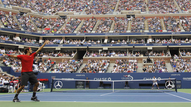 Roger Federer of Switzerland serves to Novak Djokovic of Serbia during a semifinal match at the U.S. Open tennis tournament in New York, Saturday, Sept. 10, 2011. (AP Photo/Mike Groll)