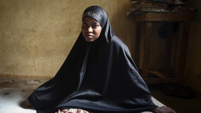 In this Oct. 10, 2012 photo, Lalla Arby, 22, who was beaten by Islamist group Ansar Dine for sitting outside her home in Timbuktu with her head uncovered, poses for a picture wearing a headscarf of the type residents of the north are now forced to wear, in Bamako, Mali, where Arby now lives with relatives. In recent months, al-Qaida and its allies have taken advantage of political instability within Mali to push out of their hiding place and into the towns, taking over an enormous territory which they are using to stock arms, train forces and prepare for global jihad. And as 2012 draws to a close and the world hesitates, delaying a military intervention, the extremists who seized control of the area earlier this year are preparing for a war they boast will be worse than the decade-old struggle in Afghanistan. (AP Photo)