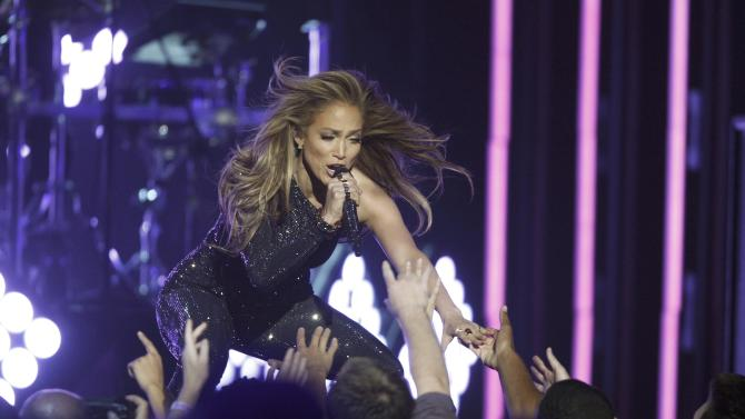 "Singer Jennifer Lopez performs ""First Love"" onstage at the 2014 Billboard Music Awards in Las Vegas"
