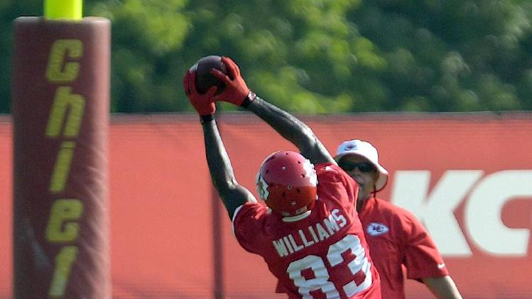 Kansas City Chiefs wide receiver Fred Williams (83) hauls in a reception during NFL football camp Tuesday morning, July 22, 2014, in St. Joseph, Mo