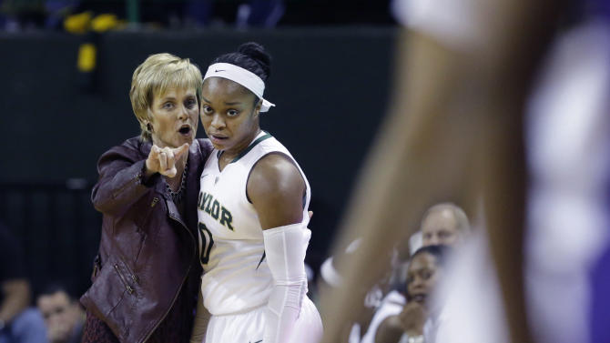 Baylor head coach Kim Mulkey, left, gives directions to Baylor guard Odyssey Sims (0) during the first half of an NCAA college basketball game against TCU, Saturday, Jan. 11, 2014, in Waco, Texas. (AP Photo/LM Otero)