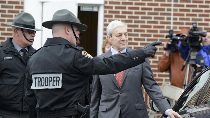 Former Penn State president Graham Spanier leaves Harrisburg District Judge William Wenner's office Wednesday Nov. 7, 2012 in Harrisburg, Pa. Spanier was arraigned and released on bail at the brief court appearance on charges he lied about and concealed child sex abuse allegations involving former assistant football coach Jerry Sandusky. (AP Photo/Jason Minick)