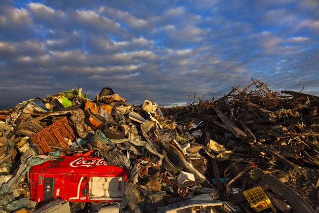 In this July 24, 2011 photo, debris lies in heaps after the tsunami swept inland across the contaminated town of Namie, Japan, and covers an area where a residential neighborhood once stood. (AP Photo