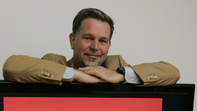"""FILE - O this July 25, 2008, file photo, Netflix CEO Reed Hastings poses for a photo at Netflix headquarters in Los Gatos, Calif. A new book,""""Netflixed: The Epic Battle for America's Eyeballs,"""" is set to go on sale Thursday, Oct. 11, 2012. The book tries to debunk a widely told tale about the company's origins and paints a polarizing portrait of its star CEO Reed Hastings. (AP Photo/Paul Sakuma)"""