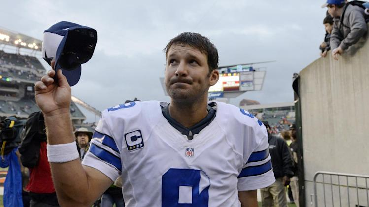 Dallas Cowboys quarterback Tony Romo leaves the field after the Cowboys defeated the Cincinnati Bengals 20-19 in an NFL football game, Sunday, Dec. 9, 2012, in Cincinnati. (AP Photo/Michael Keating)