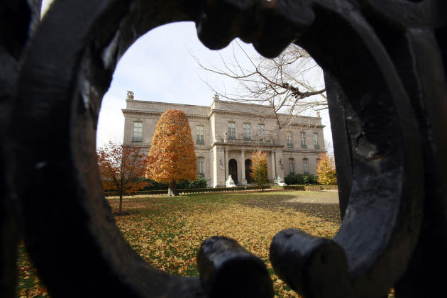 This Nov. 19, 2010 file photo shows the Elms mansion as seen through an opening in an iron fence, in Newport, R.I.  Newly discovered photographs, documents and family histories have inspired the creat