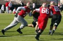 San Francisco 49ers tackle Joe Staley, guard Joe Looney, and guard Al Netter work on blocking drills during a NFL Super Bowl XLVII football practice in New Orleans