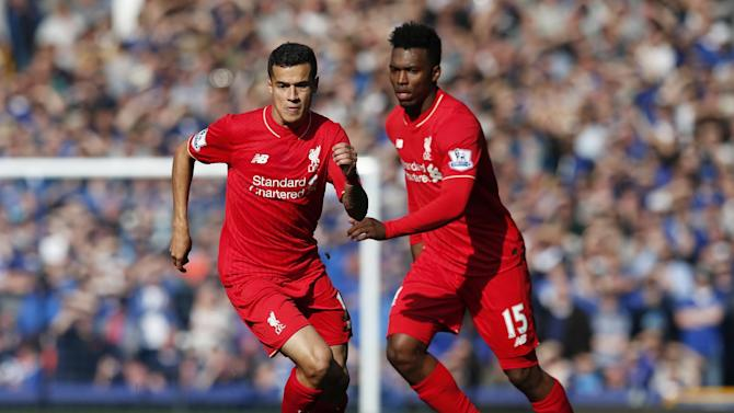 Liverpool's Daniel Sturridge and Philippe Coutinho in action