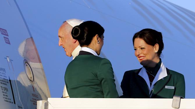 Pope Francis boards a plane at Fiumicino Airport in Rome