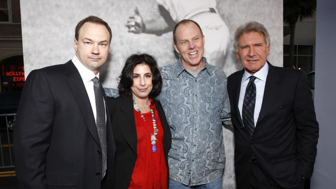 """Producer Thomas Tull, Warner Bros.' Sue Kroll, Director and Screenplay writer Brian Helgeland and Harrison Ford arrive at the LA premiere of """"42"""" at the TCL Chinese Theater on Tuesday, April 9, 2013 in Los Angeles. (Photo by Todd Williamson /Invision/AP)"""