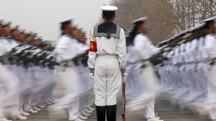 Chinese People's Liberation Army Navy recruits march during a parade to mark the end of a semester at a military base of the North Sea Fleet, in Qingdao