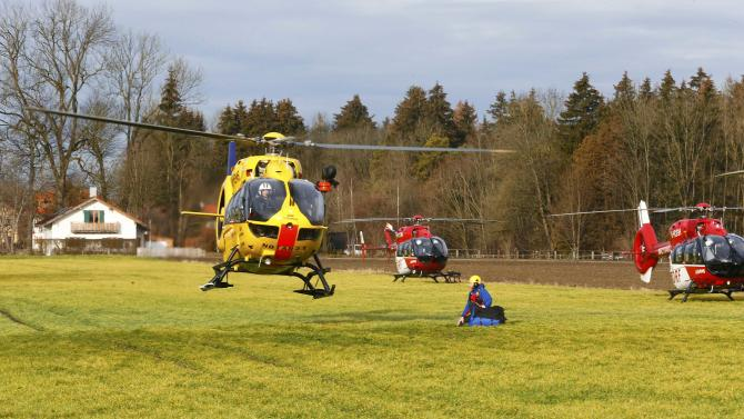 Helicopters of rescue services are seen at a field near Bad Aibling