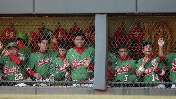 Nuevo Laredo, Mexico, players watch from the dugout in the sixth inning of a baseball game against Aguadulce, Panama, at the Little League World Series, Thursday, Aug. 23, 2012, in South Williamsport, Pa. (AP Photo/Matt Slocum)
