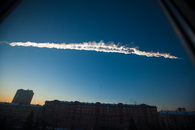 In this photo provided by Chelyabinsk.ru a meteorite contrail is seen over Chelyabinsk on Friday, Feb. 15, 2013. A meteor streaked across the sky of Russias Ural Mountains on Friday morning, causing 