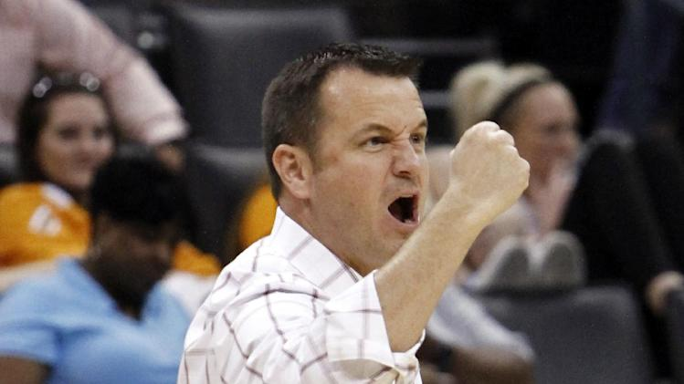 Louisville head coach Jeff Walz reacts to a basket by his team against Baylor in the first half of a regional semifinal in the women's NCAA college basketball tournament in Oklahoma City, Sunday, March 31, 2013. (AP Photo/Alonzo Adams)