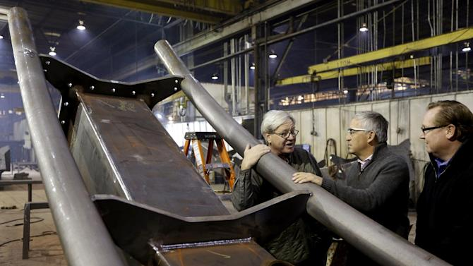 Cedar Fair CEO Matt Ouimet, center, tours the Clermont Steel Fabricating plant with plant representative Bob Mampe and Cedar Fair vice president of planning and design Rob Decker, right, Wednesday, Jan. 9, 2013, in Batavia, Ohio. Ouimet is encouraged about the company's future and the industry and believes one key is keeping people happy. He said the company's new dramatic roller coaster under construction in southwest Ohio will help achieve that goal. (AP Photo/Al Behrman)