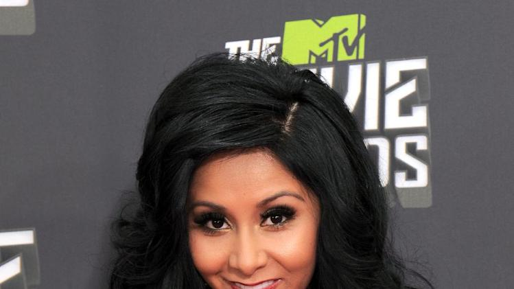 "Nicole ""Snooki"" Polizzi arrives at the MTV Movie Awards in Sony Pictures Studio Lot in Culver City, Calif., on Sunday April 14, 2013. (Photo by Jordan Strauss/Invision/AP)"