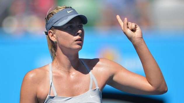 Russia&#39;s Maria Sharapova gestures during her match against Belgium&#39;s Kirsten Flipkins at the Australian Open (AFP)