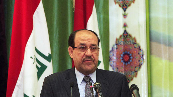 Iraqi Prime Minister Nouri al-Maliki speaks during Convergence of religions conference in Baghdad, Iraq, Saturday, April 27, 2013. Gunmen killed 10 people in Iraq, including five soldiers near the main Sunni protest camp west of Baghdad, the latest in a wave of violence that has raised fears the country faces a new round of sectarian bloodshed. The attack on the army intelligence soldiers in the former insurgent stronghold of Ramadi drew a quick response from al-Maliki, whose Shiite-led government has been the target of rising Sunni anger over perceived mistreatment.(AP Photo/Karim Kadim)