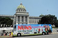 "The ""Nuns on the Bus"" arrives at the state capitol in Harrisburg, Pennsylvania on June 28. The religious group which is traveling by bus across the US is protesting proposed federal budgets cuts that would affect poor families"