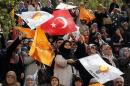 Supporters of the ruling AK Party wave Turkish and party flags during an election rally in Konya