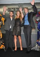 Shia LaBeouf, Rosie Huntington-Whiteley and Michael Bay wave to fans at the 'Transformers: Dark of the Moon' stage greeting at Osaka Station City Cinema in Osaka, Japan, on July 16, 2011  -- Getty Images