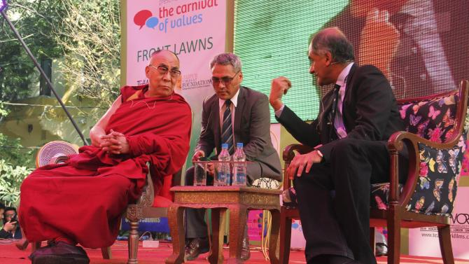 The Dalai Lama, left, listens to one of his biographers, Pico Iyer at one of the sessions on the opening day of India's Jaipur Literature Festival in Jaipur, India, Thursday, Jan. 24, 2013. This year's festival will also feature author Zoe Heller and Booker Prize winner Howard Jacobson. (AP Photo/Deepak Sharma)