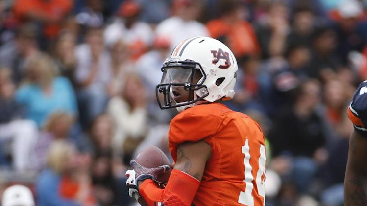 Auburn quarterback Nick Marshall drops back to throw in the first half of the NCAA college football team's A Day spring game Saturday, April 19, 2014 in Auburn, Ala