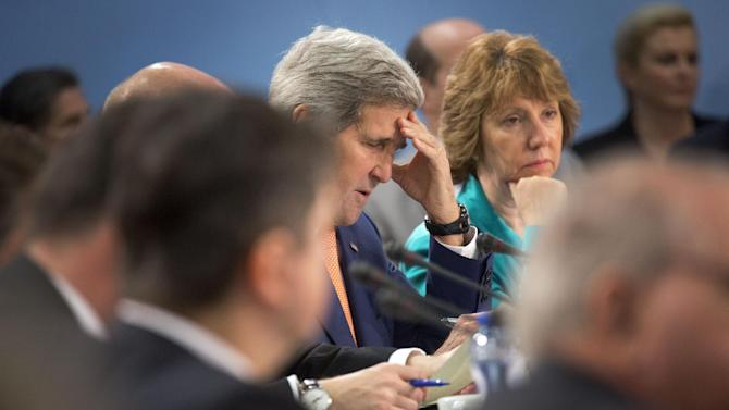 U.S. Secretary of State John Kerry, center left, attends a meeting of the North Atlantic Council in Foreign Ministers Session at NATO headquarters in Brussels on Wednesday, June 25, 2014. The Brussels meeting is the final gathering of high-ranking government officials before the summit of NATO's leaders scheduled for September in Wales. U.S. Secretary of State John Kerry and his colleagues are expected to fine tune the summit's agenda on a wide array of topics, from how to redeploy NATO's forces in response to Russian capabilities and actions to what to do in Afghanistan when NATO's combat mission in that country comes to an end this December. (AP Photo/Virginia Mayo)