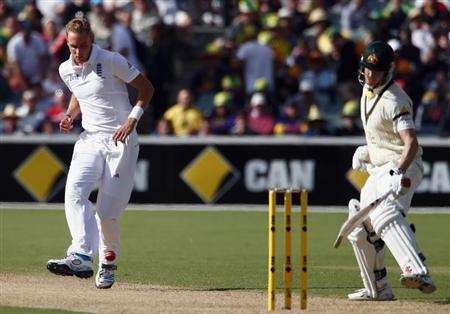 England's Broad kicks the ball towards Australia's Bailey during the first day's play in the second Ashes cricket test at the Adelaide Oval