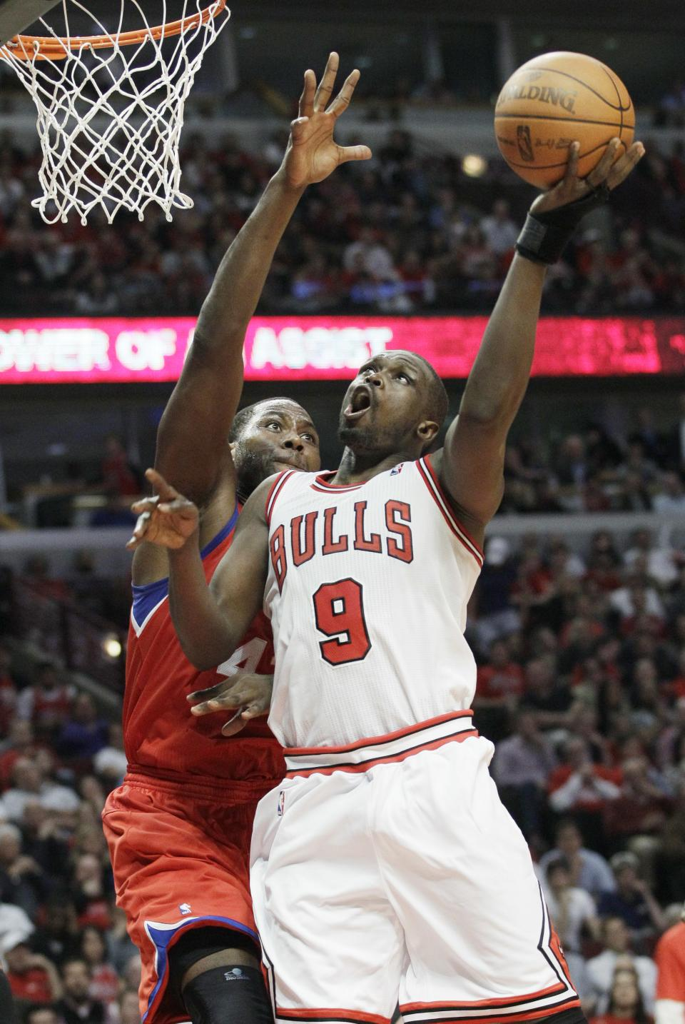 Chicago Bulls forward Luol Deng (9) shoots against Philadelphia 76ers forward Elton Brand (42) during the fourth quarter of Game 5 in an NBA basketball first-round playoff series, in Chicago on Tuesday, May 8, 2012. The Bulls won 77-69. (AP Photo/Nam Y. Huh)